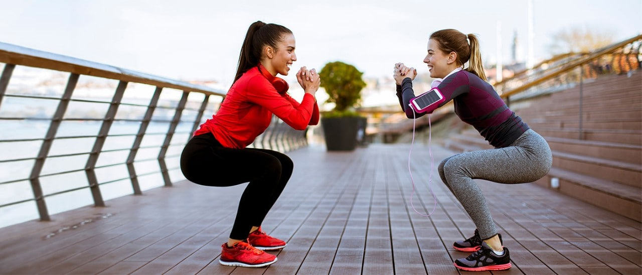 Two women exercising outside