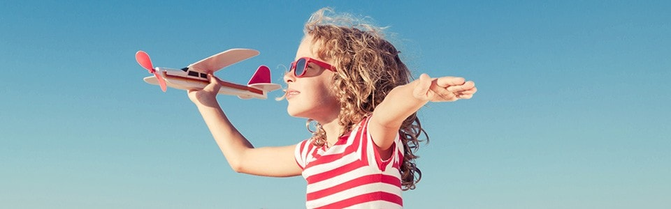 Young girl holds a toy airplane