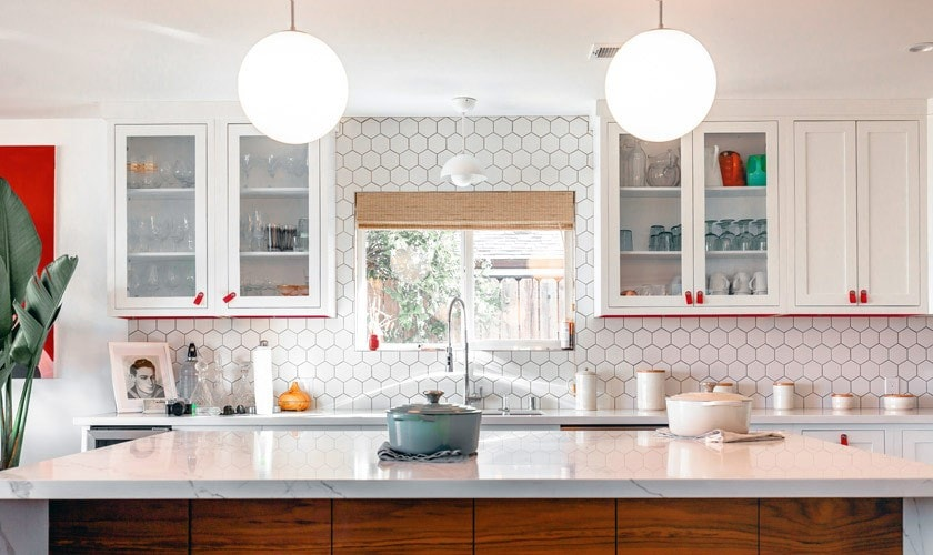 A bright kitchen with cabinets and a window